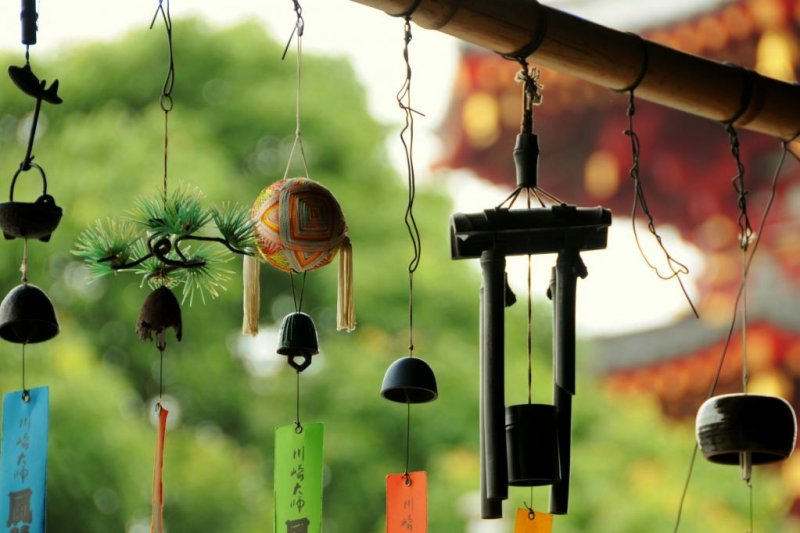 Furin beautifully displayed in front of the temple's pagoda
