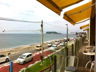 Terrace side seating with a view of Enoshima Island