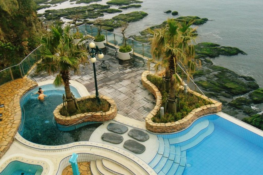 View of outdoor pools from a seat in the 4th floor Italian restaurant