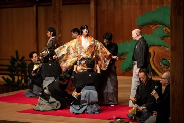 It takes time and skills to put on Noh costumes