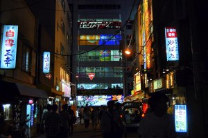 Akihabara side street at night, facing a multi-level store