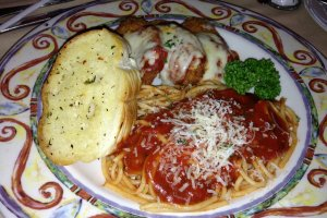 Chicken parmesan served with spaghetti marinara and garlic bread