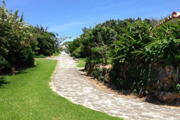 Toguchi Beach Park's paved pathways go up and down the limestone bluffs as well as along the shoreline
