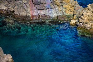 Rainbow cliffs meet the clear blue Sea of Japan