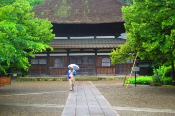 The Genji family crest is visible atop the thatched roof of Chosho-ji