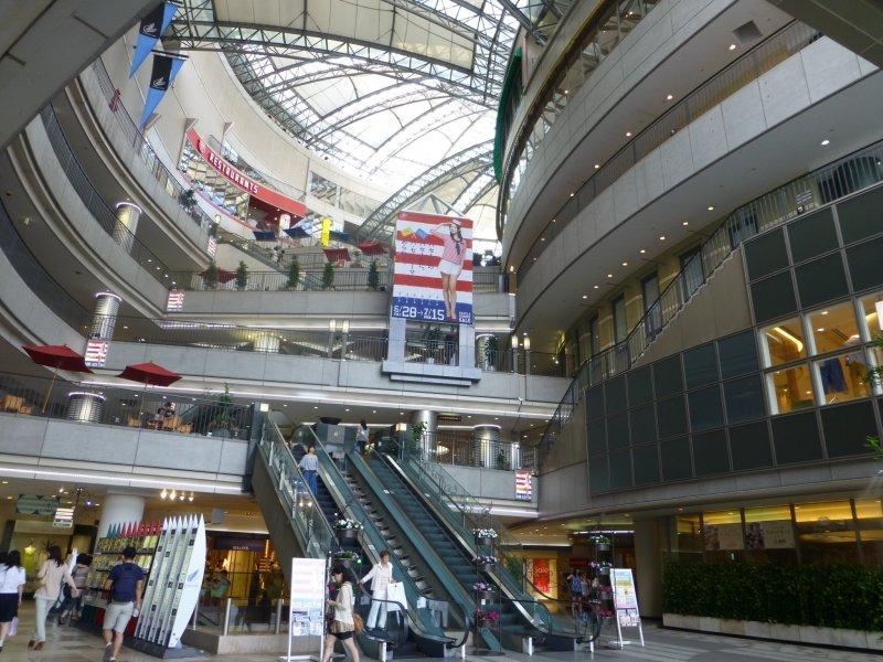A modern multi-story building with 11 levels of shops and eateries
