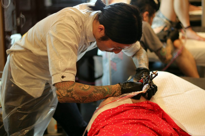 Hiroshi is hard at work tattooing my piece.