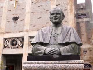 A bronze statue of Pope John Paul II is on display near the entrance to the Cathedral