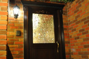 One of two crystal-paned doors in the waiting room of Swallowtail