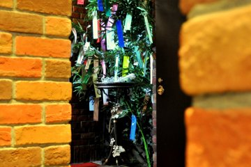 At the bottom of the steps, the tree is decorated with wishes for the approaching Tanabata Festival