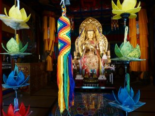 Colorful displays brighten up a dark room in the temple