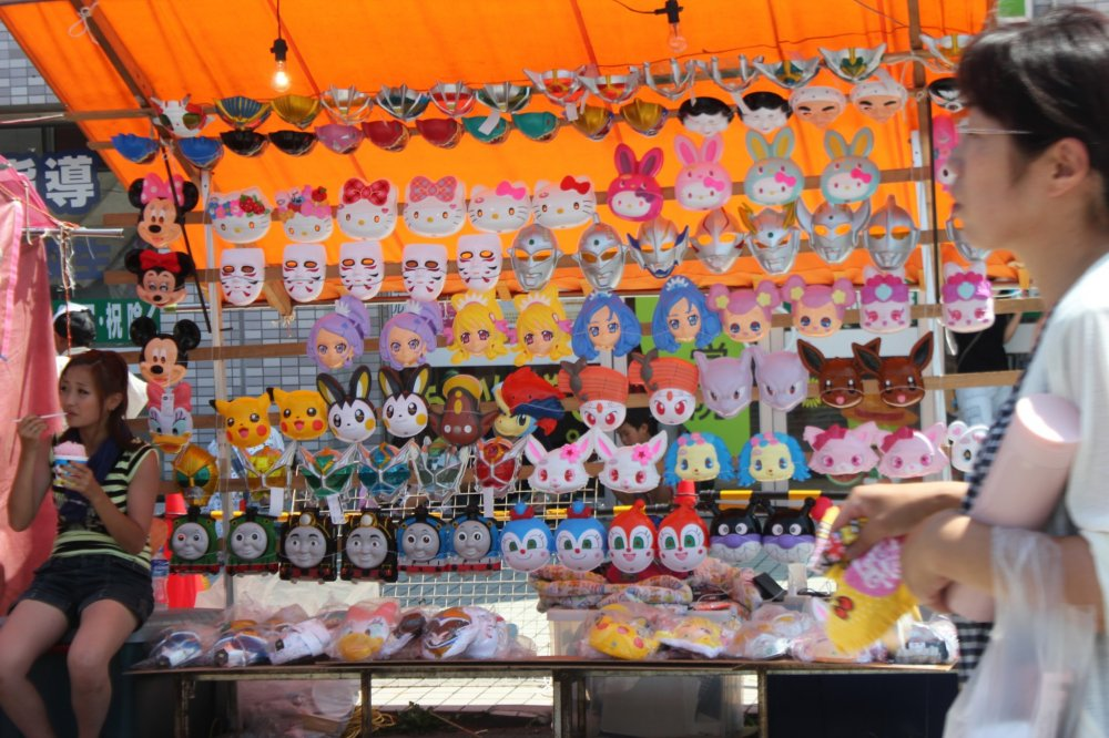 """Most children like these masks, called """"omen"""" in Japanese."""