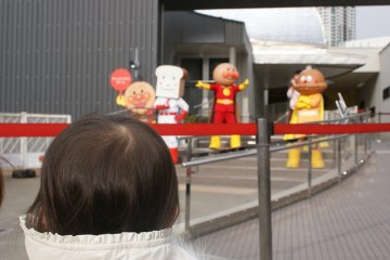 Child being mesmerized by the life sized characters