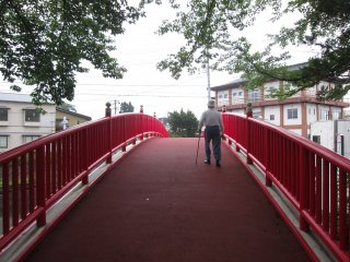 The Red Bridge that links the park to the other side of town