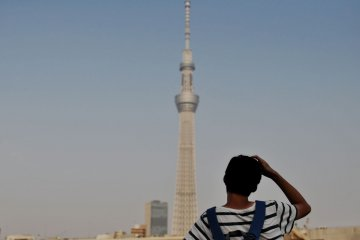 A visitor observing the Skytree Building