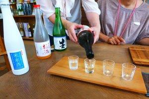 Sake sampling at Kamoizumi brewery