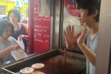 Korean staff chat with guests at Mr. Hottoku in Shin-Okubo