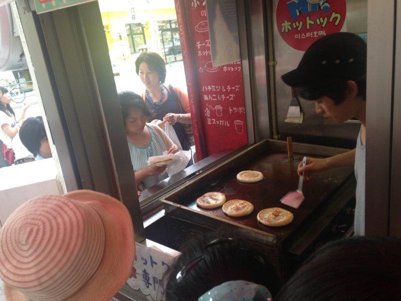 Guests ogle gooey Mr. Hottoku creations in Shin-Okubo