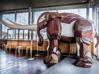 Part of this Café's stylish interior includes a giant wooden elephant sculpture