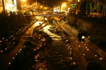 Night view of the beautiful river which runs through the hot spring town