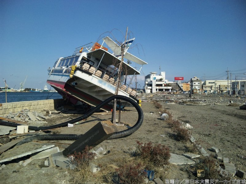 A passenger ferry washed onto land