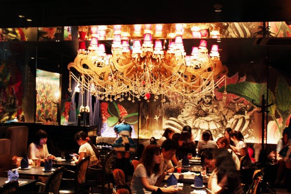 Dine under a spectacular chandelier at Alice\'s Fantasy Restaurant in Shinjuku.