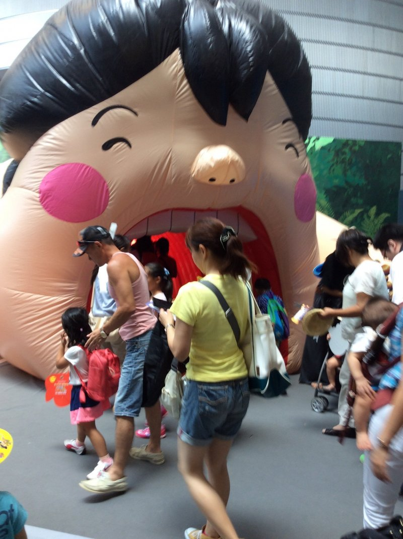 Enter the exhibition through a giant inflated mouth