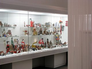 A collection of regional dolls and toys