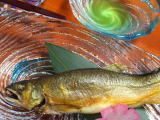 """I chuckled at this! Ayu - not the most photogenic fish - served with a radish """"flower"""" for presentation"""