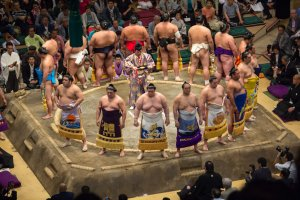 Wrestlers wearing kesho-mawashi on the dohyo ring
