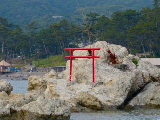 Red torii (Shinto gate) on the rocks