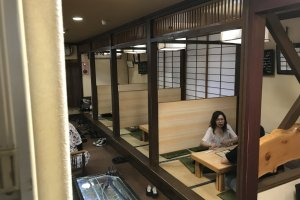 The first floor offers bar, table, and tatami booth seating