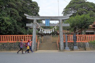 By a Shinto shrine