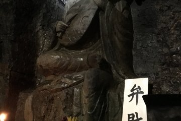Benzaiten, the only female deity among the Seven Gods of Fortune in Japan, the goddess of water and the one who bestows language and letters, sits in a cave