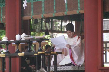 Shinto priests wear black caps as a symbol of enlightenment