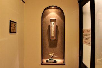 Haiku poems, bonsai plants and ikebana flower arrangement works can be found throughout