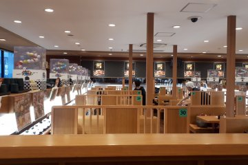 The easy interior of a modern sushi-train restaurant