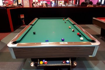 One of the many billiard tables