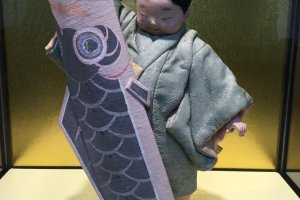 Dolls depicting ordinary people are also on display.