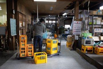Preparing sake to be sold in the shops