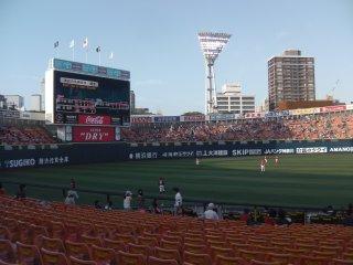 The visiting Hiroshima Carp warm up pre-game