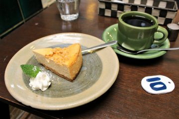 A caramel cheese cake and coffee