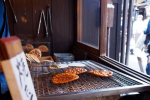 Senbei rice crackers being grilled