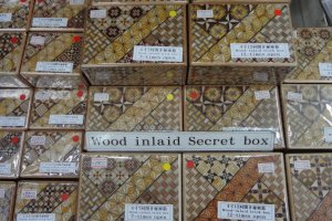 Mosaic work with parquetry-like patterns adorn these boxes. The box itself is a puzzle.