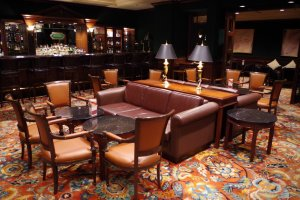 Leather couches with wooden furnishings bring the visitors back in time