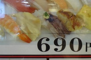 """If you have no idea what to choose, """"Omakase (oh-mah-kah-say) sushi"""" is easy. It is a sushi set that includes 10 pieces of seasonal sushi for only 690 yen"""