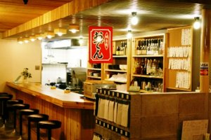 The short counter is an intimate place for a drink or snack.
