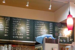 The handwritten menu behind the counter
