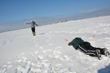 The water is frozen solid in winter, and so flat that you can use it for fun photo opportunities