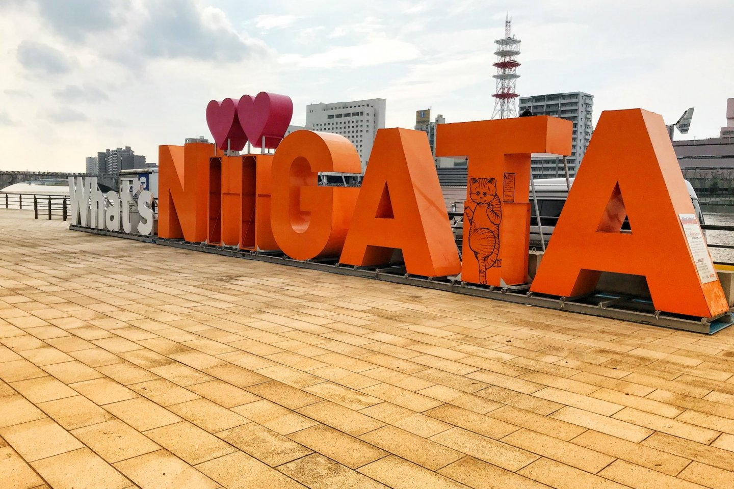 The What\'s Niigata sign is a fun photo opportunity in the city